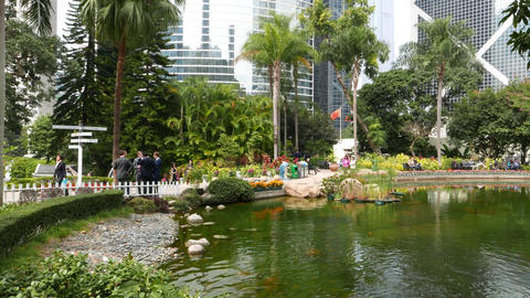 Group of office managers take break in Hong Kong park Footage