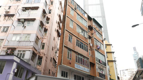 Sharp house corner parallax low angle shot, typical Hong Kong Island perspective Footage
