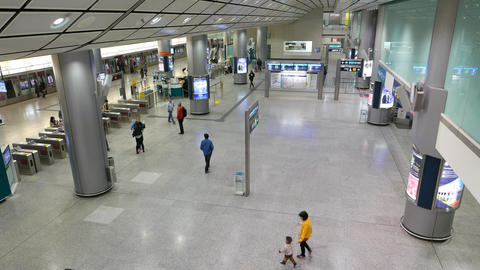 Hong Kong airport express train arrive, passengers alight and walk turnstile Footage