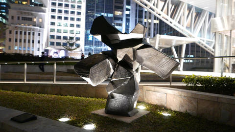 Abstract cubed human figure steel sculpture, parallax shot in night Footage