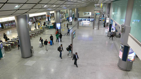 People come through express train station hall, arrive from airport Footage