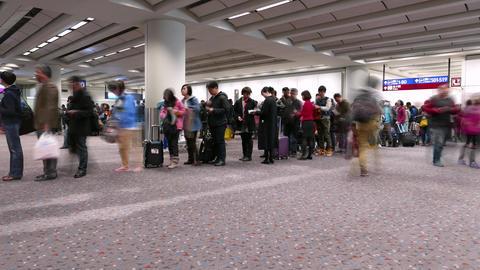 Man standing in airport against departure people queue. TIMELAPSE Footage