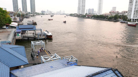 Chao Phraya river and piers near Taksin bridge, top view, several boats Footage