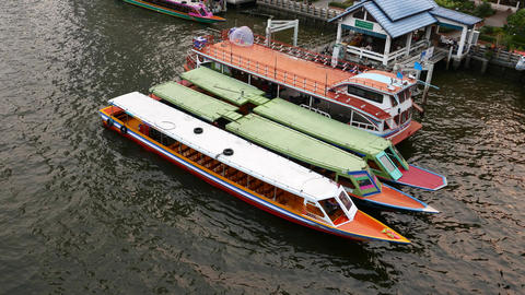 Long narrow boats parked side by side at small pier, top view, high angle Live Action