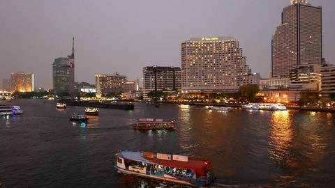 Beautiful evening view of Chao Phraya river at Taksin bridge, illuminated boats Footage