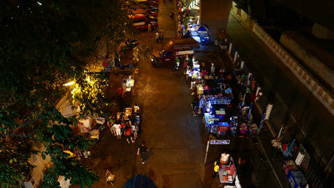 Pedestrian area under Saphan Taksin station, street eatery, songthaew terminal Footage