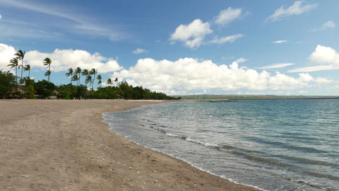 Empty beach at tropical island, calm water, panning left Footage