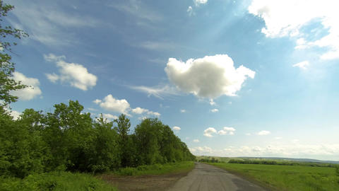 Clouds over the road. The path from Terenga village, Ulyanovsk region, Russia, F Footage