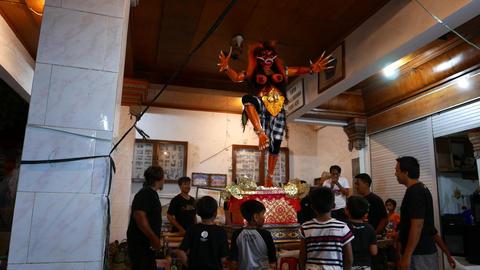 Ogoh-ogoh statue indoor preparation, children hold… Stock Video Footage