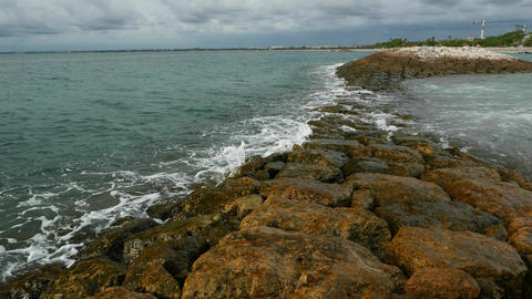 Moving Backward By Wet Breakwater, Small Waves Washing Stones stock footage