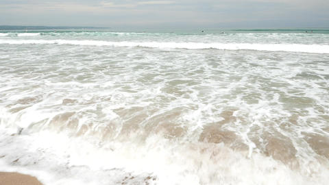 Close up surf ocean water on tropical beach, ambient noise Footage