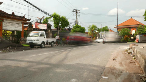 Ghostly Traffic Sunny Road, Low Angle, Balinese Street, Timelapse Shot stock footage