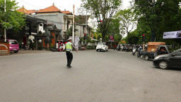 Active police officer regulate traffic on busy balinese junction, loud whistling Footage