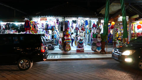 Tropical resort cloth shop, colorful accessories, girld garments, parallal shot Footage
