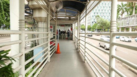 Transjakarta busway shelter entrance, approach by overpass ramp Footage