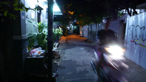 Motorbike approaching at scary dark alley, moving camera Footage