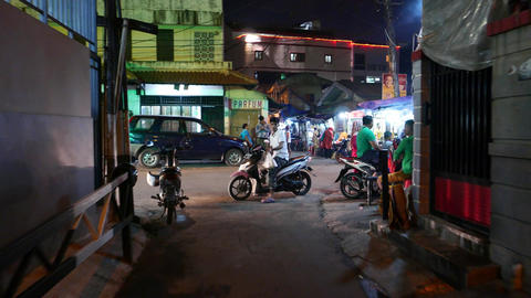 Boy turn around and drive towards and away on motorbike, night bystreet Footage