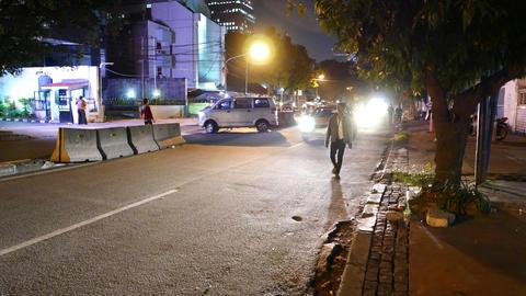 Two Volunteer Pointsman On Night Street, Helps Car To Turn Cross Road stock footage