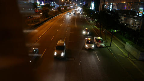 Panning shot over night road, light traffic move under, top point view Live Action