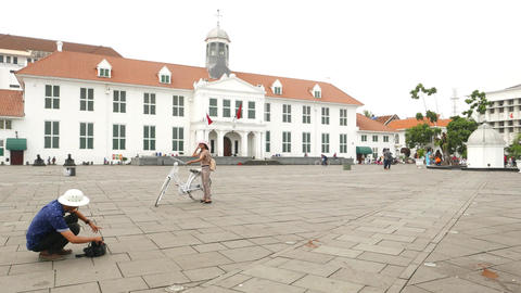 Tourist Couple, Take Picture Against Jakarta History Museum With Bike stock footage