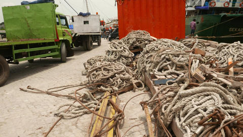 Heap of ropes, wire ropes, hawser and cable on the dusty ground, close up Footage