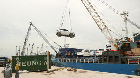 Car Lift Up By Luffing Crane And Boarded On Ship Deck stock footage