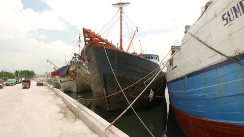 Old wooden ships prow, moorage area of Sunda Kelapa, moving camera Live Action