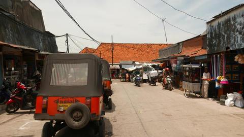 Wide road to slum area, fish market passage, Sunda Kelapa harbor Footage