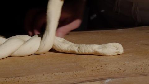 german baker bread plait braid challah spotlight dolly 4k 11768 Footage