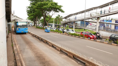 Blue Transjakarta bus approach and rush by bus stop. road perspective view Footage