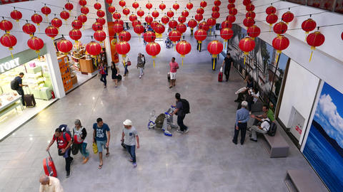 Airport concourse passage from above, decorated with chinese lanterns Footage