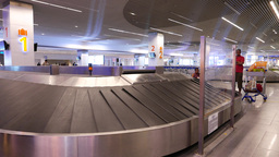 Empty conveyor carousel at airport arrival hall, luggage reclaim area Footage