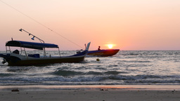 Fishing boat sway on sea waves, beautiful sunset, motorboat sweep by Live Action
