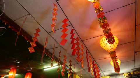 Red paper squares garland hanging under ceiling, chinese decoration Footage