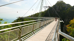 Langkawi SkyBridge perspective, cute girl pose, then come towards camera Footage