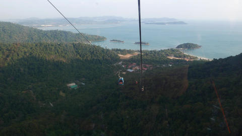 Travel down in cable car gondola, mountain landscape view Live Action