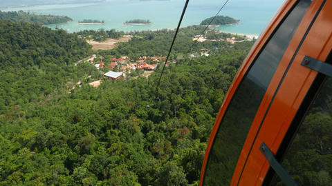 View down from within aerial lift, SkyCab, Langkawi Oriental Village aerial view Footage
