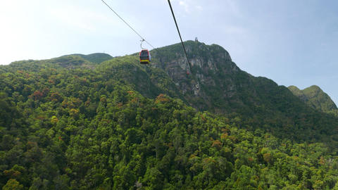 Aerial lift travel, rainforest mountain peak, picturesque view Live Action