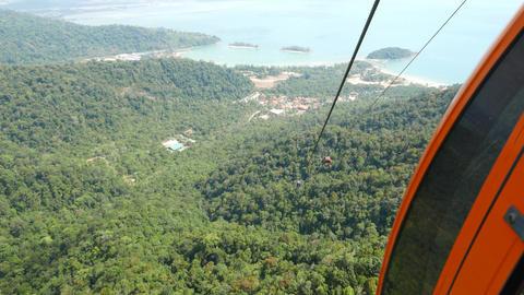 Move up within gondola lift, Langkawi SkyCab, lowland sunny panorama Footage