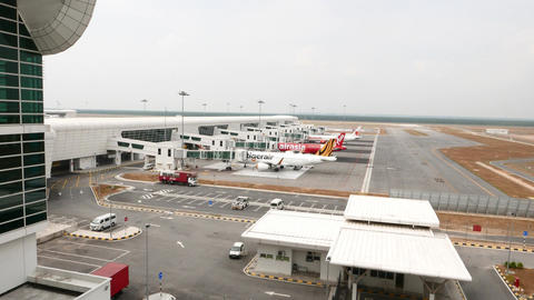 Airport outdoors panning shot, air planes in line at gate exits Footage