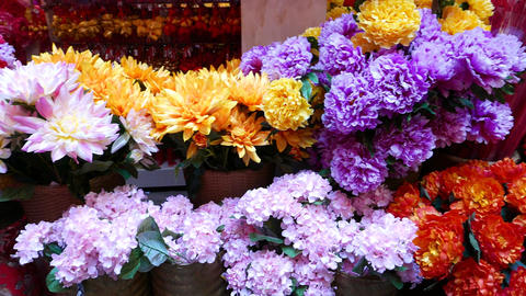 Artificial flowers market stall, colorful phloxes and chrysanthemums Footage