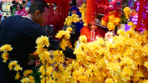 Chinese new year decorations and plastic items stall on market, looking in Footage