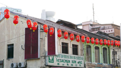 Oblong Red Chinese Paper Lanterns Hang On Street, Against Old Buildings stock footage