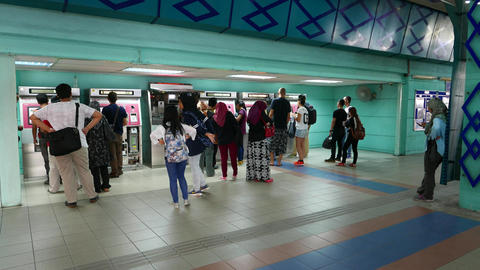 Ticket machine technical maintenance on LRT station people queue to working Footage