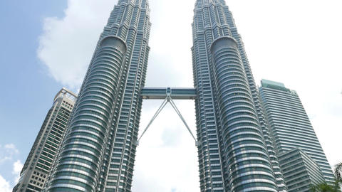 Tourist Take Pictures Of Petronas Twin Towers, Panning Up Shot stock footage