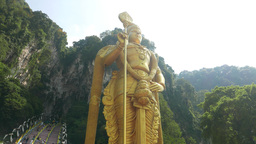 Amazing golden Murugan statue from low angle, Batu Caves entrance Footage