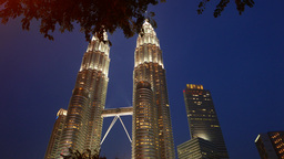 Amazing Petronas Twin Towers against night sky, long panning shot Footage