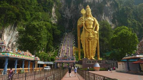 Approaching Murugan statue, moving to Batu Caves entrance Footage