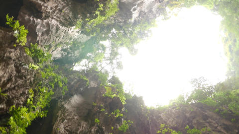 Spinning View Up From Cave Bottom, Amazing Bright Gap Opening stock footage
