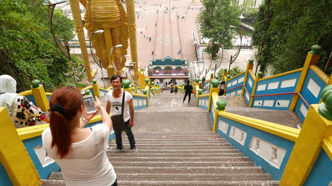 Walking down stairs from Batu Caves, tourist take pictures Footage